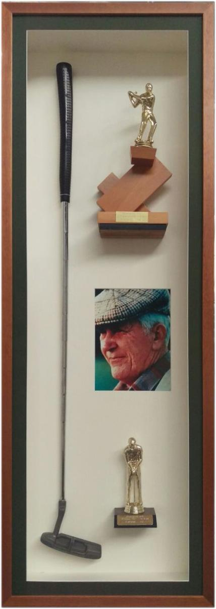 Framed golf memorabilia